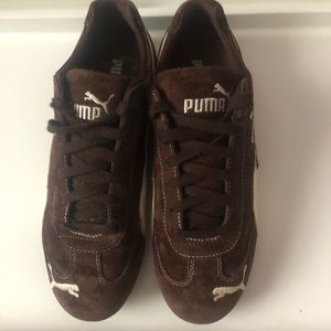 Brown and white women's puma sneakers
